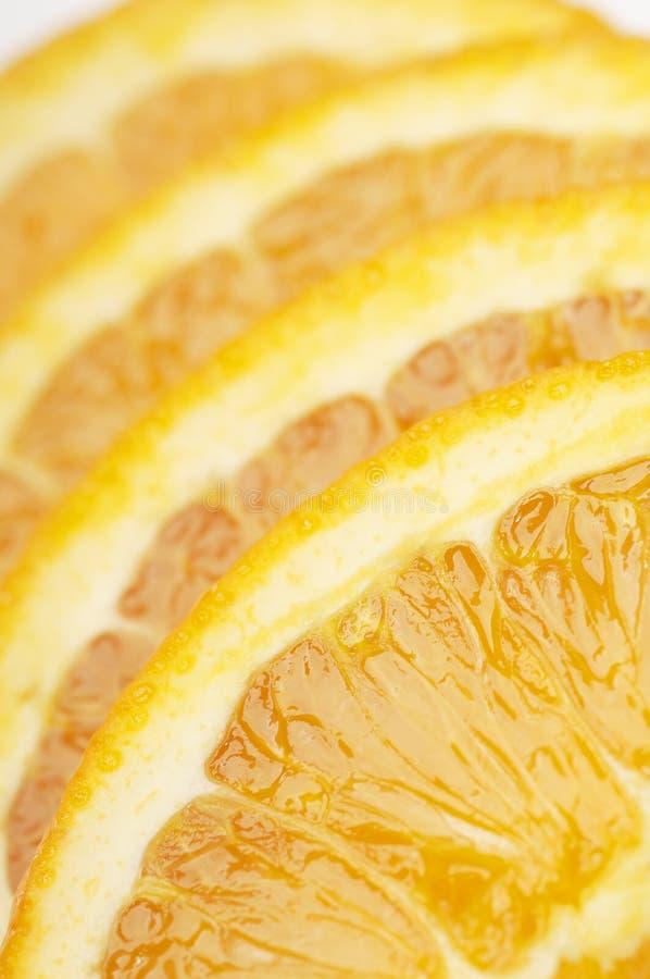Apelsinskivor i linje arkivfoton
