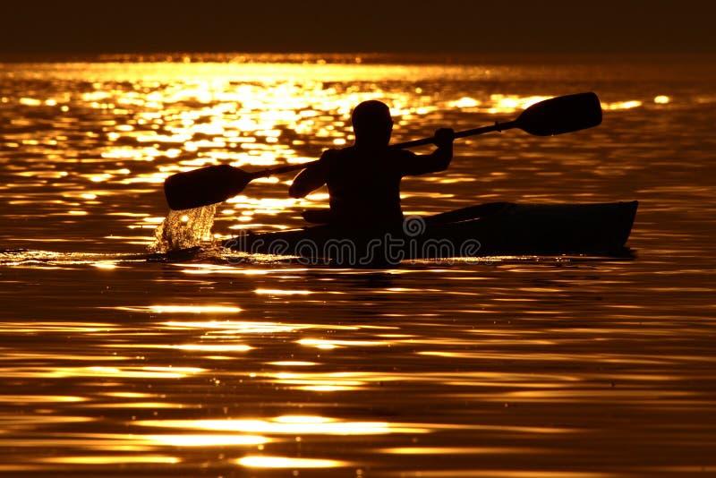 Apenas usted, agua y puesta del sol. fotos de archivo libres de regalías