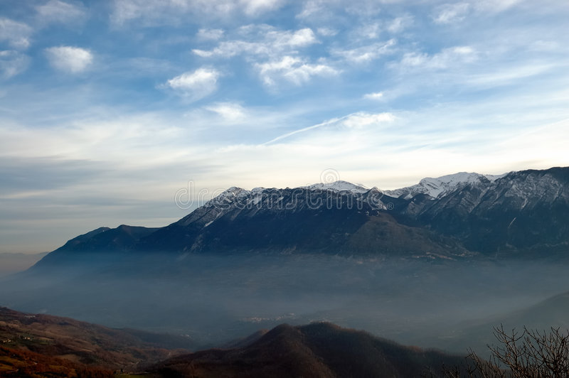 Apennines Landscape. Abruzzo (Geographical Region) apennines mountains (Central Italy) in winter. Landscape with a big misty valley stock photo