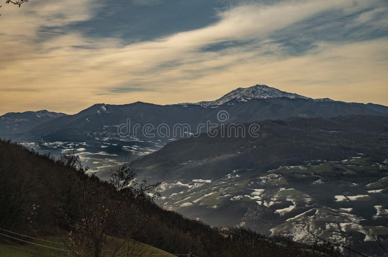 Apennines and Mount Cimone. Landscape of the Apennines with Mount Cimone in winter with traces of snow, Italy royalty free stock images