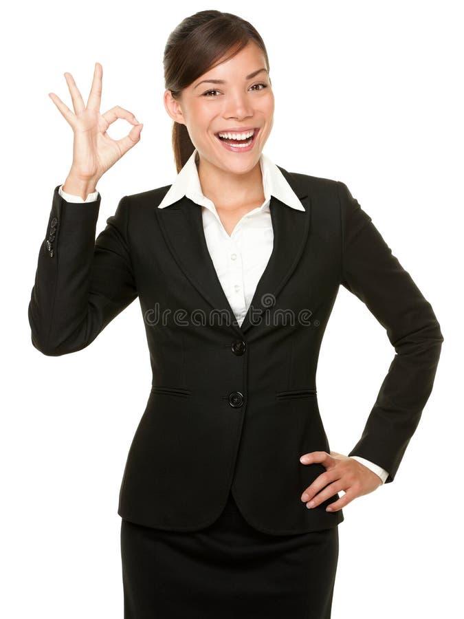 Aperfeiçoe - o sinal da APROVAÇÃO da mulher de negócio foto de stock