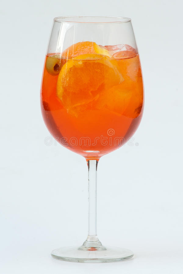 Aperol Spritz. Glass with long drinks (Spritz veneto, Sprizz, Aperol Spritz) with oranges on the table royalty free stock photo