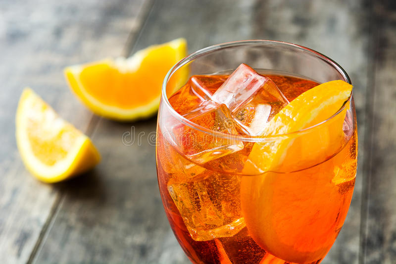 Aperol spritz cocktail in glass on wood. En table stock photos