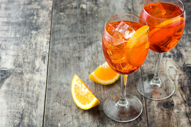 Aperol spritz cocktail in glass on wood. En table royalty free stock photos