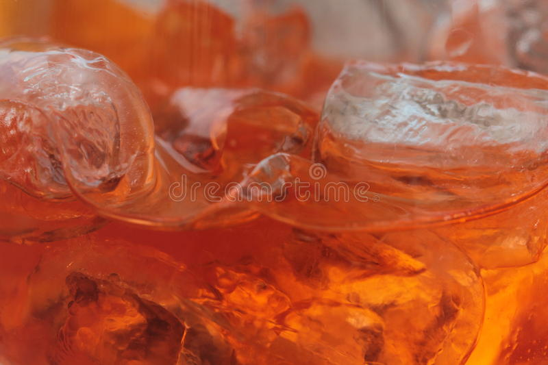 Aperol Spritz. A long cocktaii with Aperol Spritz and ice cubes, refreshing drinks, aperitif, italian, unique taste, bright orange, close up royalty free stock photo