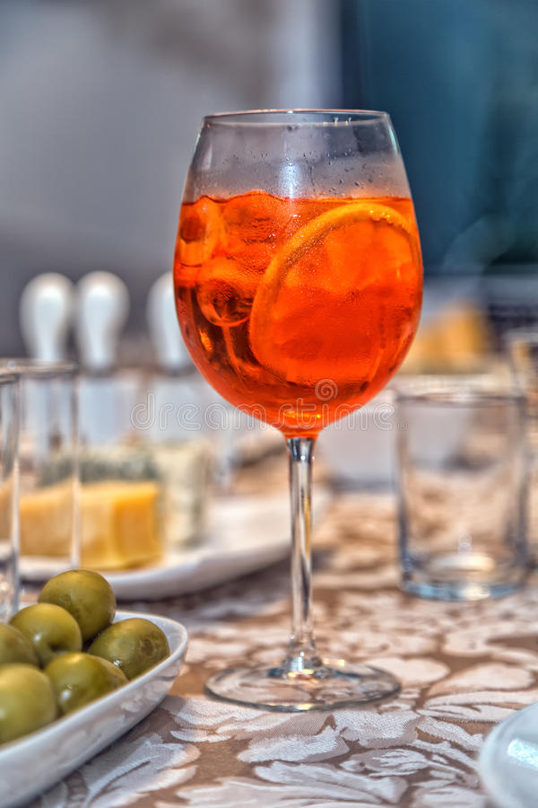 Aperol Spritz. And side of green olives stock image