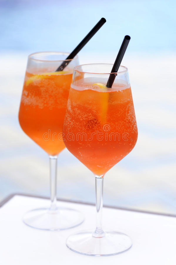 Aperol spritz at swimming pool. Aperol spritz at the swimming pool stock photos