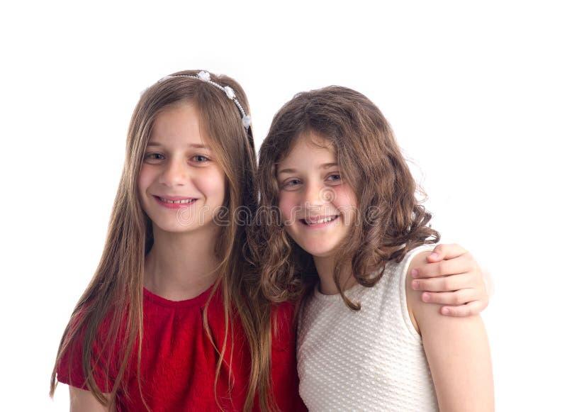 Aperto bonito de duas irmãs isolado imagem de stock