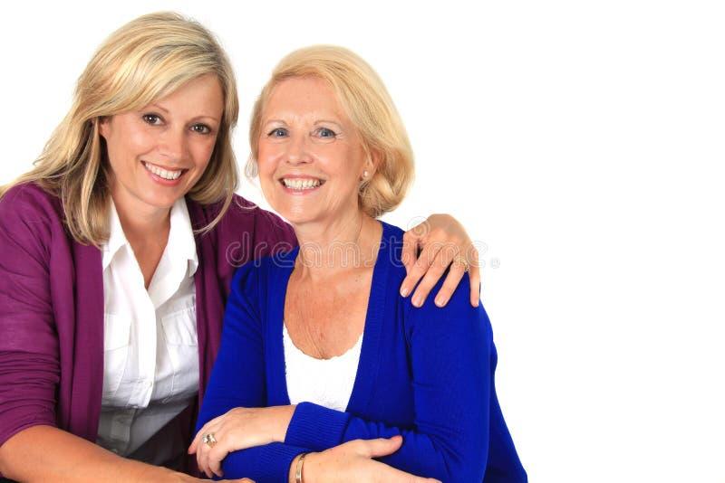 Aperto de duas mulheres foto de stock