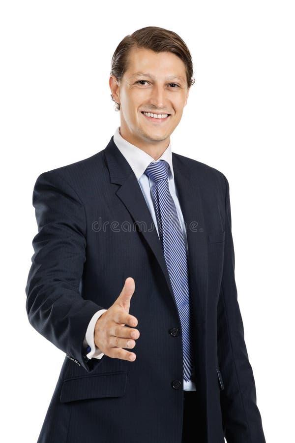 Aperto de mão amigável do homem de negócios foto de stock