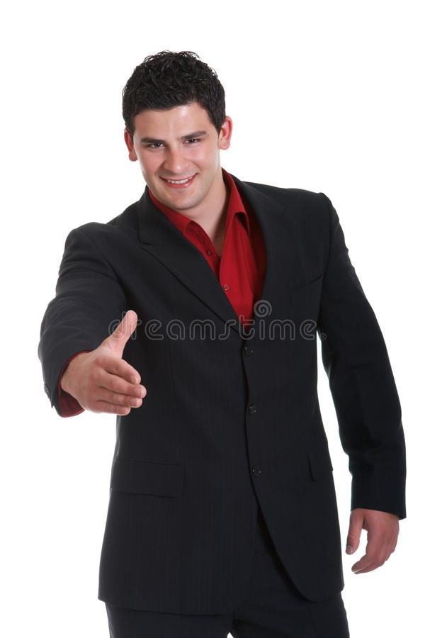Aperto de mão amigável do homem de negócios novo imagem de stock