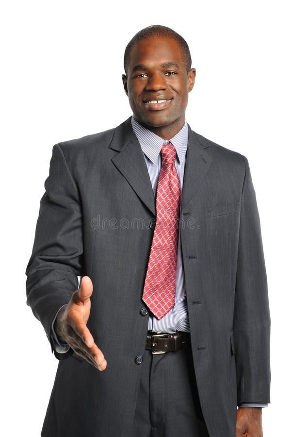 Aperto de mão de oferecimento do homem de negócios imagens de stock