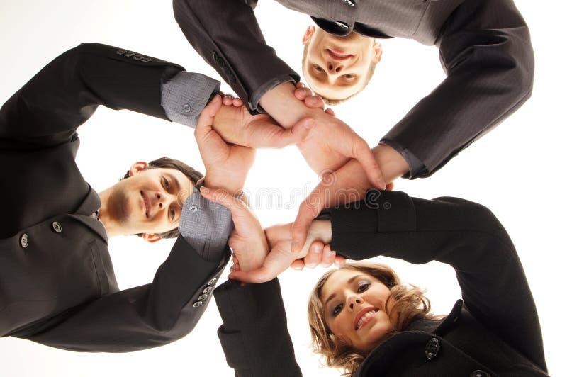 Aperto de mão do grupo com muitas mãos diferentes fotos de stock