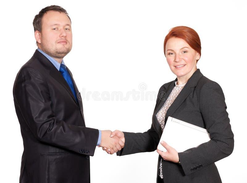 Aperto de mão entre o homem de negócios e a mulher de negócios imagem de stock