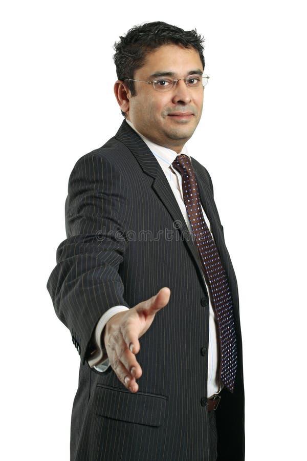 Aperto de mão indiano do homem de negócios foto de stock