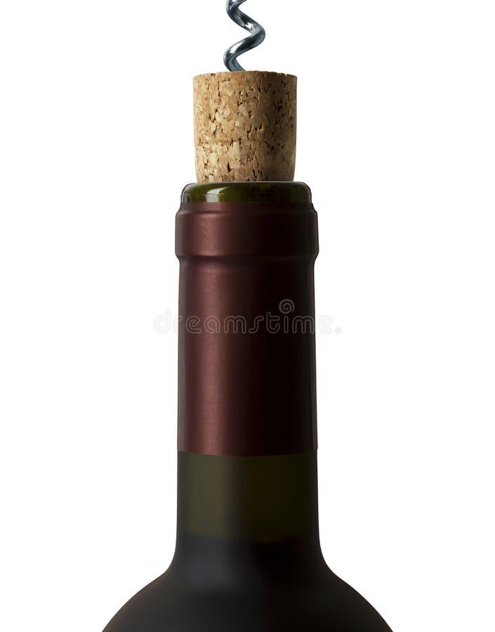 Apertura de una botella de vino foto de archivo
