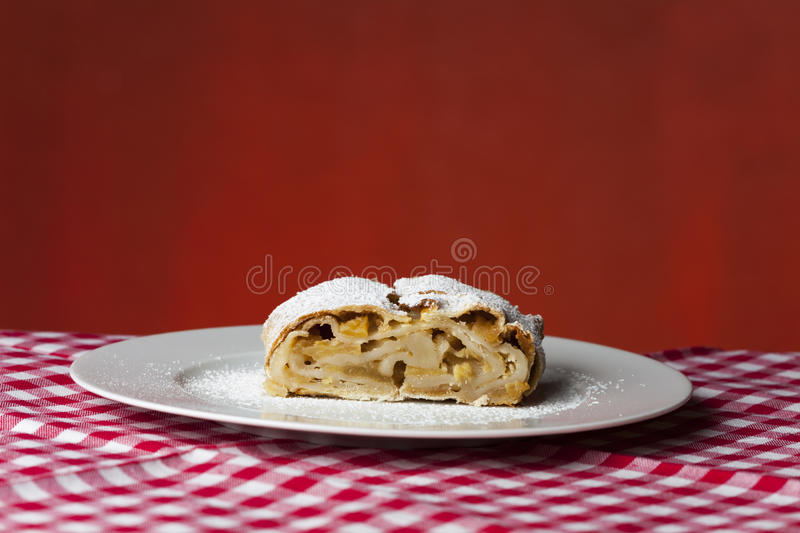 Apfelstrudel. Closeup of a apfelstrudel on a plaid cloth stock photos