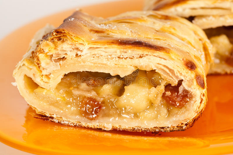 Apfelstrudel (apple pie). Studio close up of delicious apfelstrudel (apple pie) isolated on white background stock photography