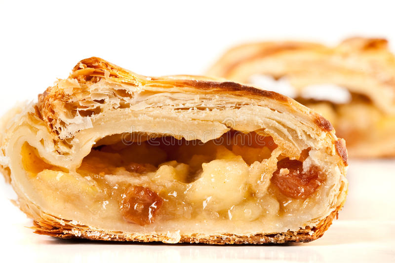 Apfelstrudel (apple pie). Studio close up of delicious apfelstrudel (apple pie) isolated on white background royalty free stock image