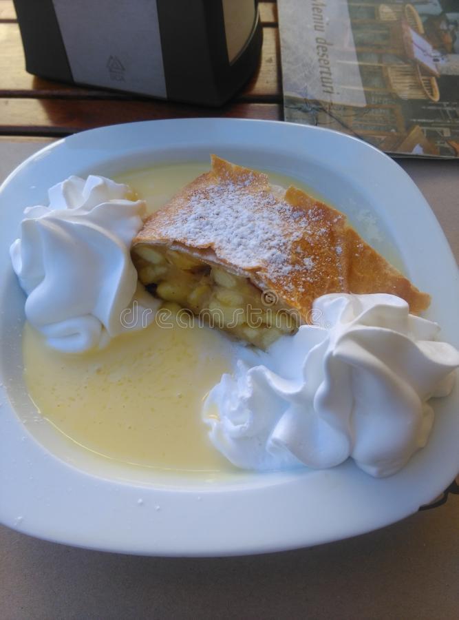 Apfelstrudel. An austrian dessert with apples and vanilla dressing royalty free stock photos
