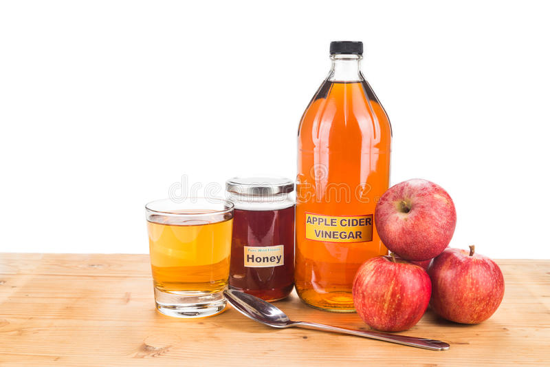 Apfelweinessig mit Honig, Naturheilmitteln und Heilungen für c lizenzfreie stockfotografie