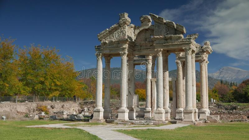 APHRODISIAS ARCHEOLOGICAL SITE, AYDIN, TURKEY - NOVEMBER 15, 2015: Ancient ruins of famous Tetrapylon Gate of the Temple stock image