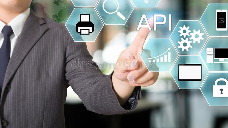 API  Application Programming Interface businessman pointing a visual icon stock photography