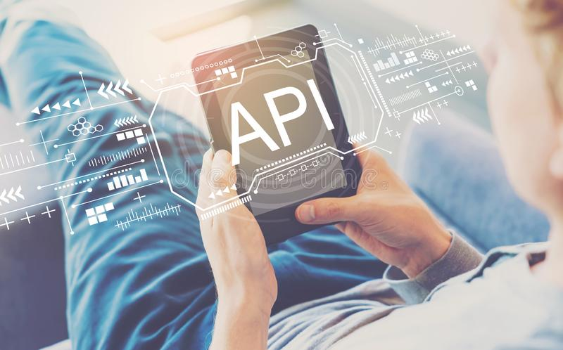 API concept with man using a tablet stock photography