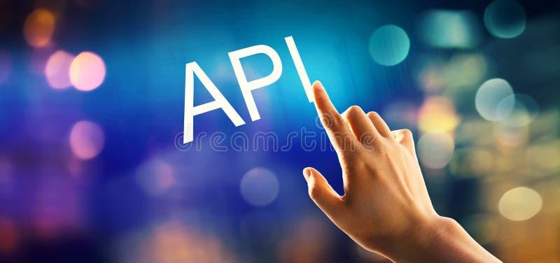 API concept met hand het drukken een knoop stock afbeeldingen