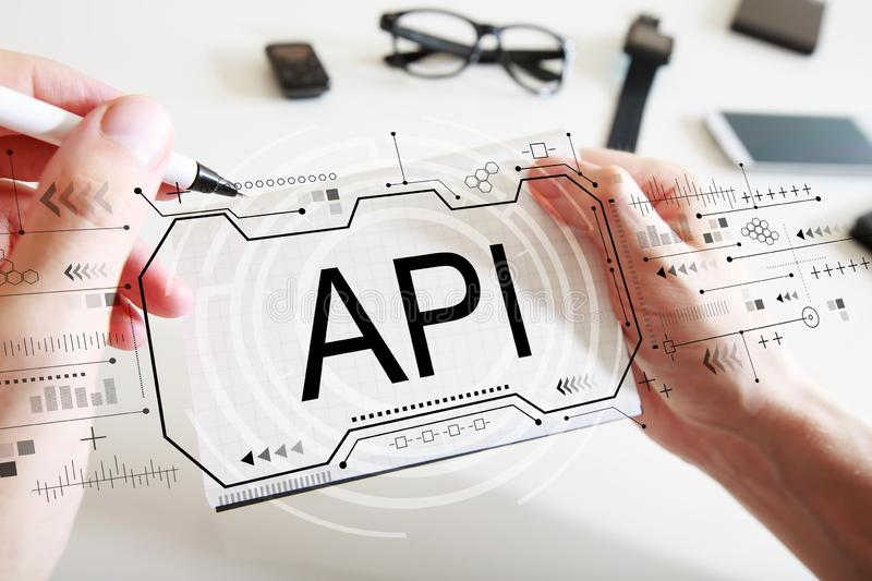 API concept with a notebook. API concept with man writing in a notebook stock photo