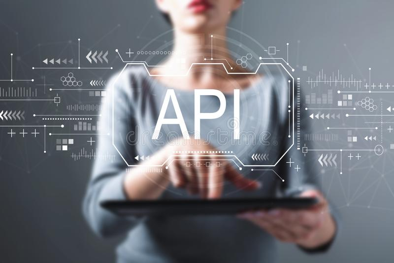 API concept with woman using a tablet royalty free stock photos