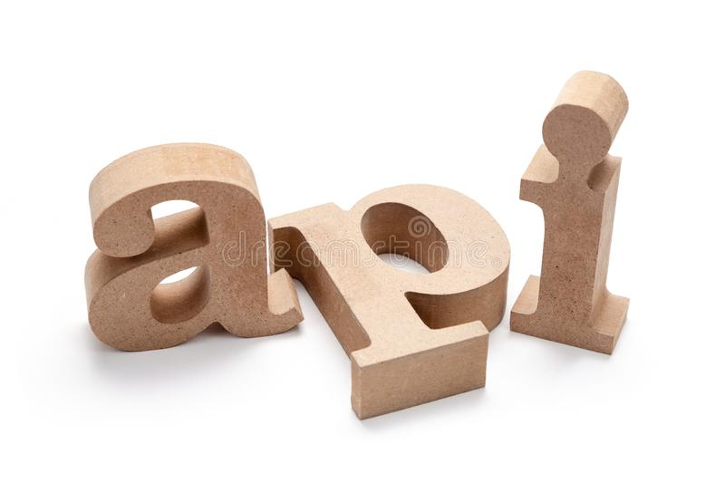 API Wood Letters. API abrreviation wood letters on white background Application Programming Interface stock images