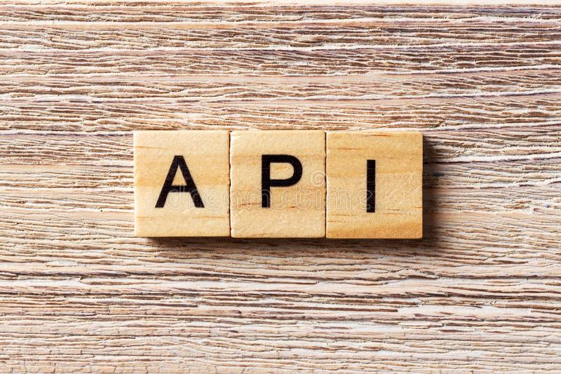API word written on wood block. application program interface text on table, concept royalty free stock photography