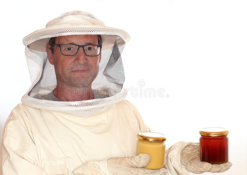 Apiarist takes two honey glasses. In hands stock photo