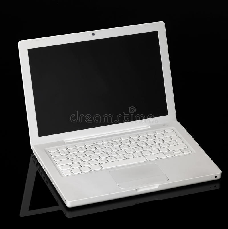 Aple Macintosh laptop. Studio shot of a white Apple laptop in black reflective back royalty free stock photography