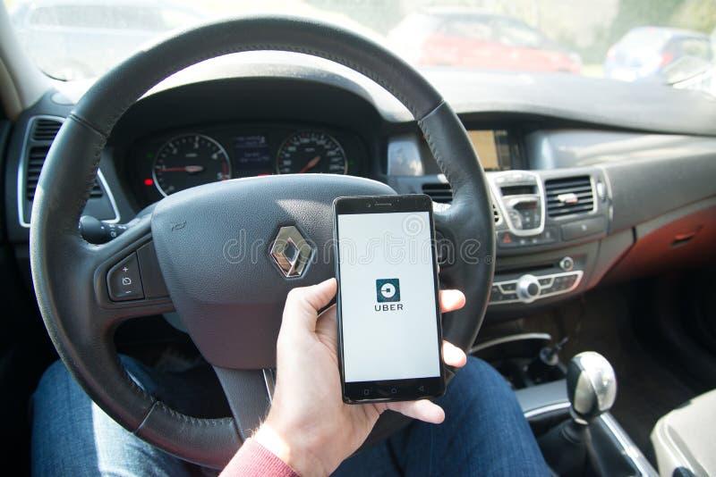 Aplicação de Uber imagens de stock