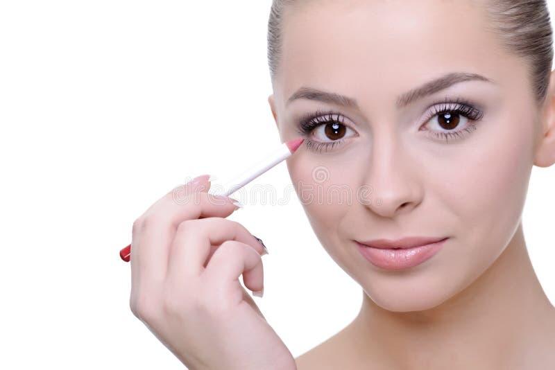 Aplicación de maquillaje fotografía de archivo libre de regalías