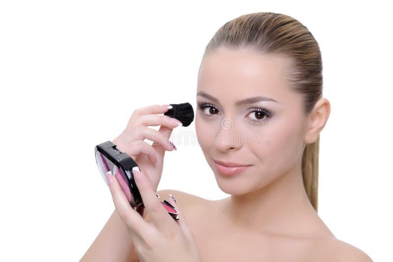 Aplicación de maquillaje imagenes de archivo