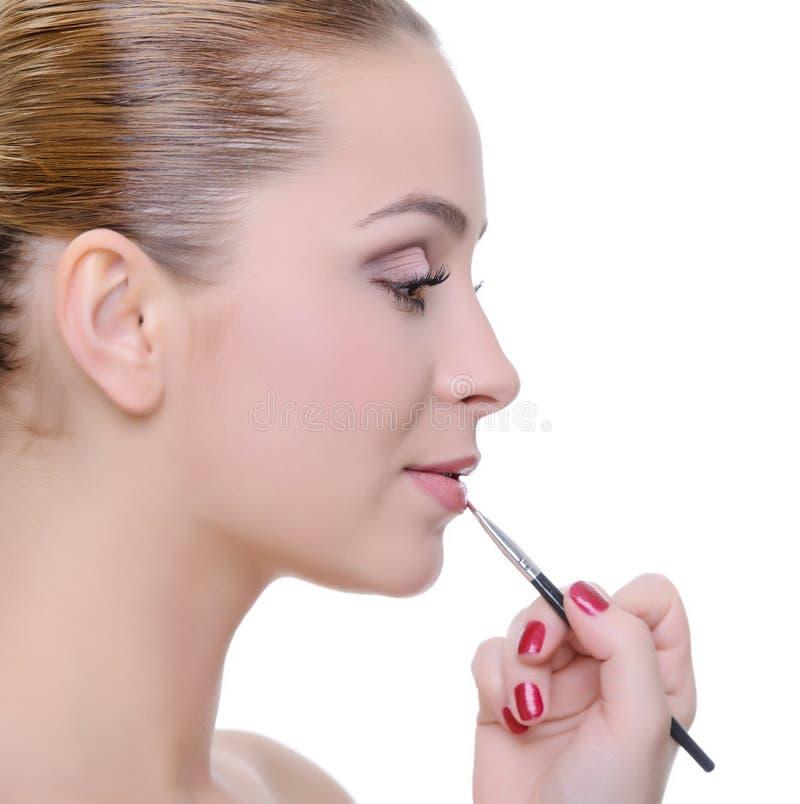 Aplicación de maquillaje fotografía de archivo