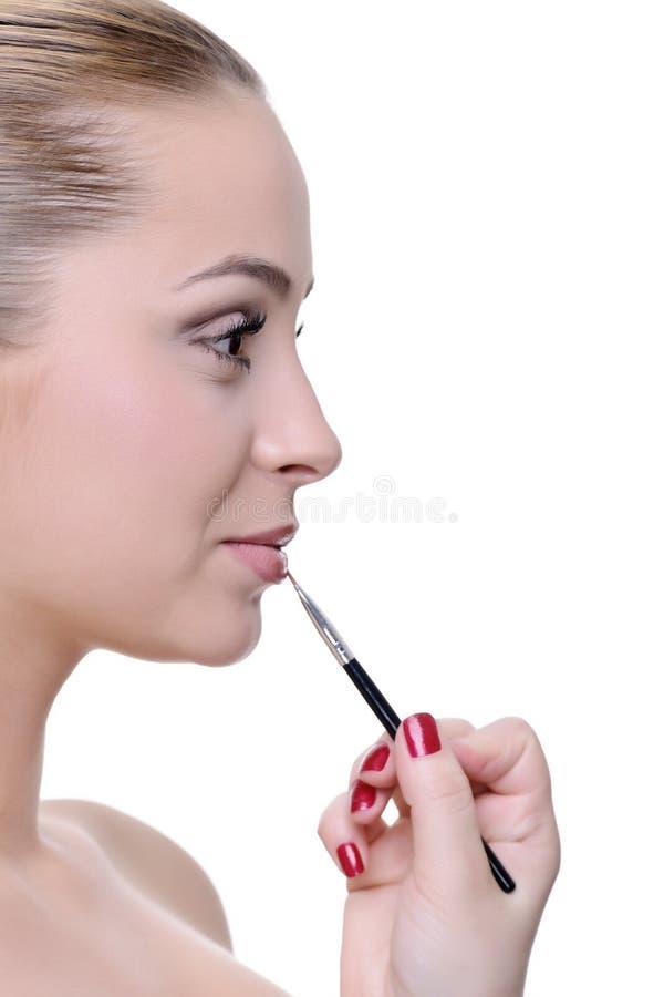 Aplicación de maquillaje imagen de archivo