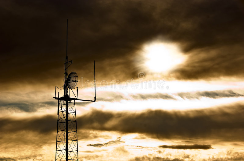 Apocalypse. TV transmitter shot on a cloudy sunset, so it looks like some kind of disaster happened and overall mood is somehow unpleasant and similar to royalty free stock photos