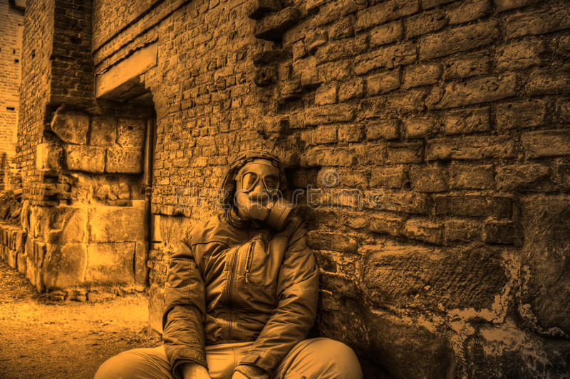 Man wearing gas mask stock image