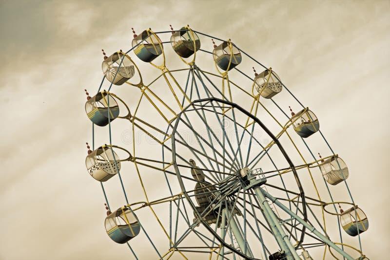 Apocalyptic ferris wheel on acrid sky grey backround. Taken closeup royalty free stock photography