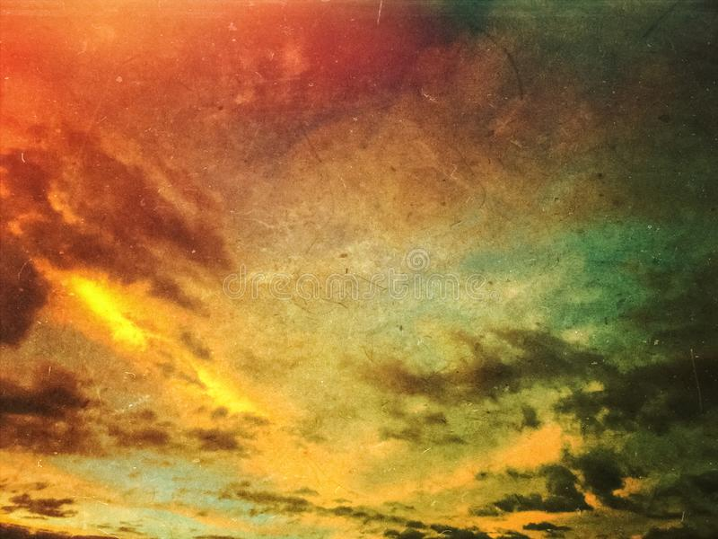 Apocalyptic grunge sunset sky background. Apocalyptic grunge sunset sky and clouds background. Dusty scratched texture stock image