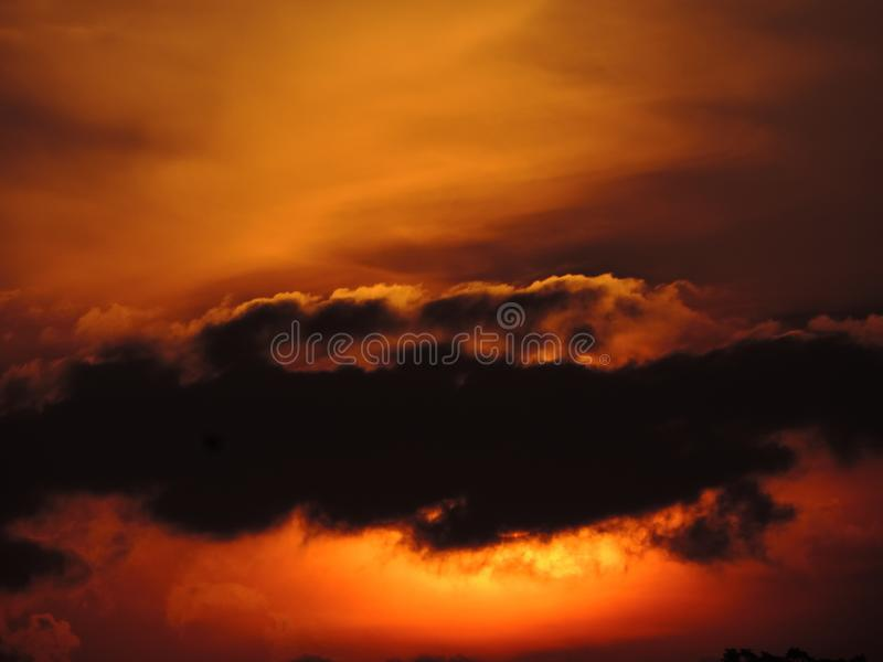 Apocalyptic sky without edition. This photo was taken at sunset with its stunning beauty without any use of editing, with a cloud capping the sun gives a more royalty free stock image