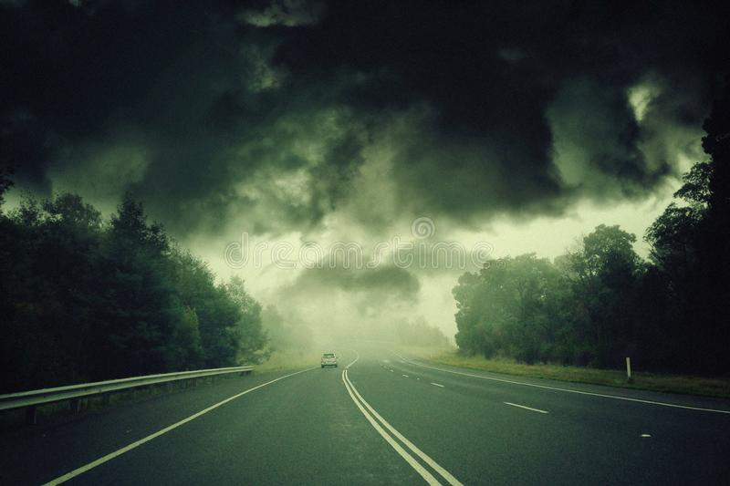 Apocalyptic storm. Eerie storm closing in on rural highway stock images