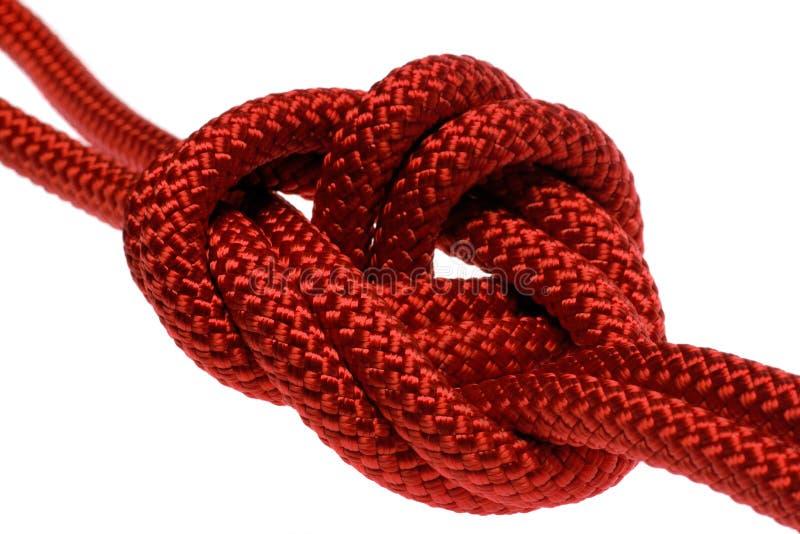 Apokrypher Knoten auf doppeltem rotem Seil lizenzfreie stockfotografie