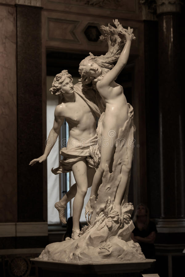 Apollo and Daphne by Gian Lorenzo Bernini. Apollo and Daphne is a life-sized Baroque marble sculpture by Italian artist Gian Lorenzo Bernini. Daphne turning stock image