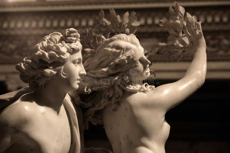 Apollo and Daphne by Gian Lorenzo Bernini. Apollo and Daphne is a life-sized Baroque marble sculpture by Italian artist Gian Lorenzo Bernini. Daphne turning stock photos