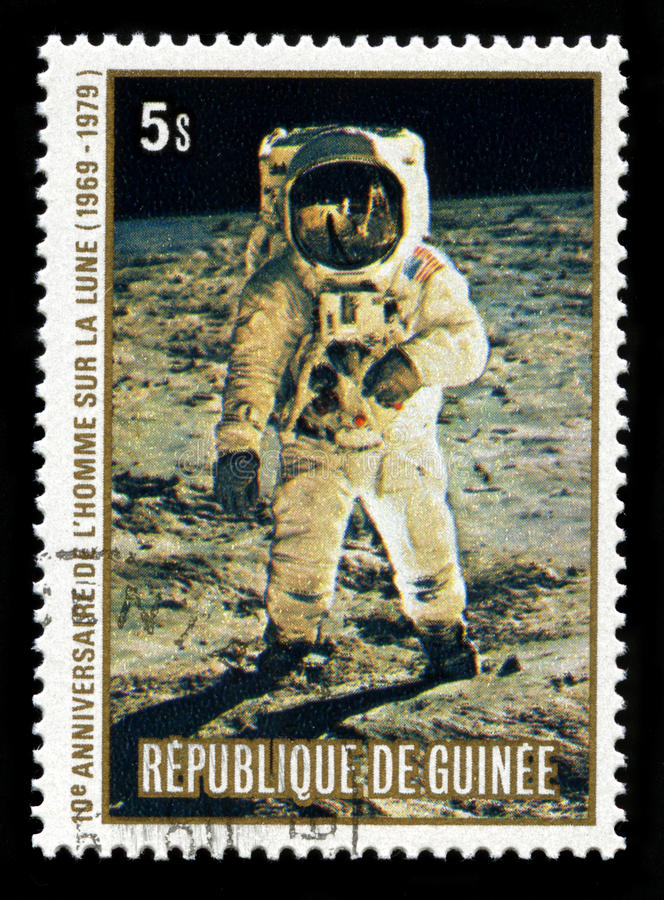 Apollo 11 Moon Landing. REPUBLIC OF GUINEA - CIRCA 1979: A postage stamp from the Republic of Guinea commemorating the 10th Anniversary of the Apollo 11 Moon stock images